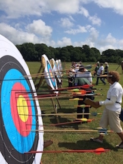 Picture of Warlingham Archery Club members scoring their arrows