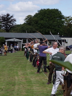 Archers shooting at the Surrey Clout Championships at Warlingham Archery Club