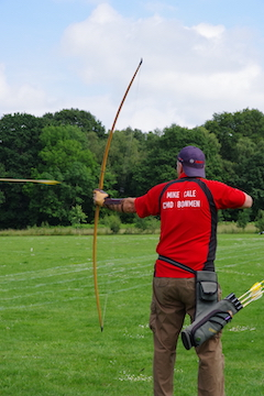 Longbow archer's arrow leaves the bow